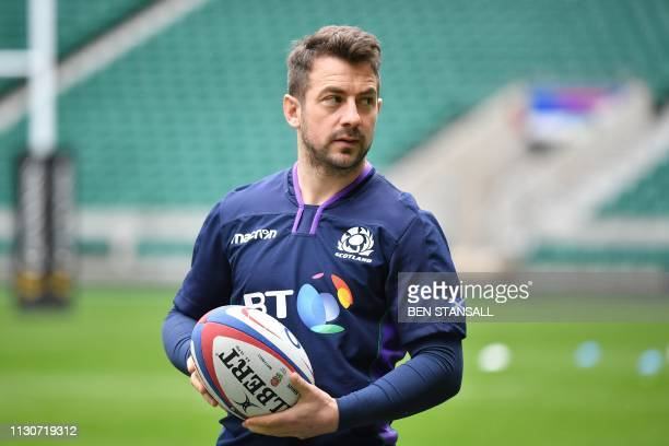 Scotland's scrumhalf Greig Laidlaw participates in the captain's run training session at Twickenham stadium in south west London on March 15 on the...