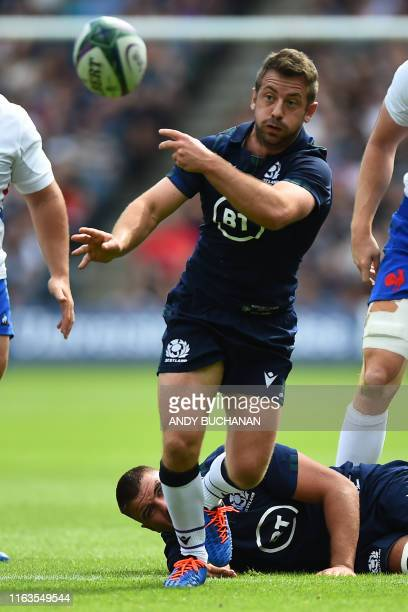 Scotland's scrumhalf Greig Laidlaw passes the ball during the international Test rugby union match between Scotland and France at Murrayfield in...