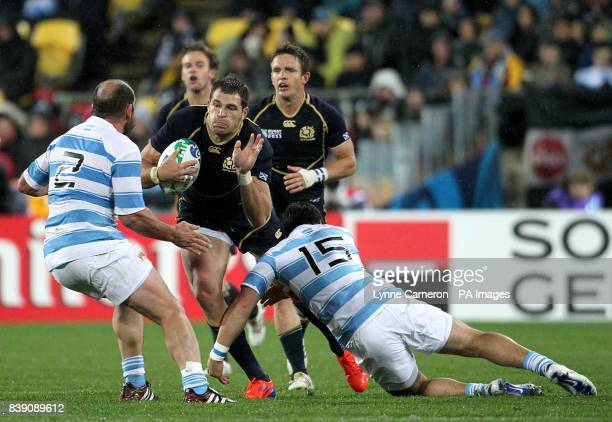 Scotland's Sean Lamont is tackled by Argentina's Mario Ledesma Arocena and Martin Rodriguez