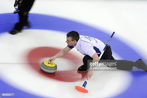 Scotland's skipper Warwick Smith shoots the stone during the Men's curling World Championship final for the Bronze Medal against the US in Cortina...