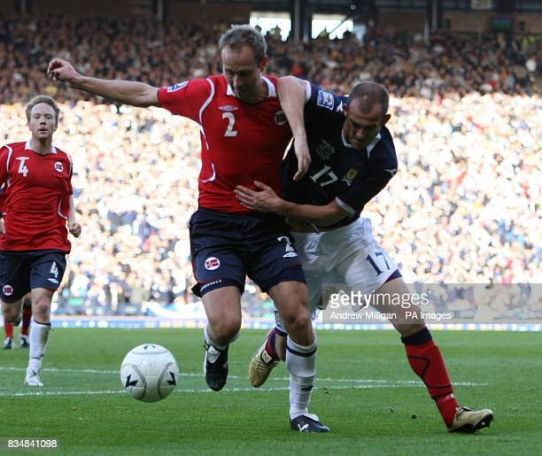 Scotland's Steven Fletcher and Norway's A Haland battle for the ball