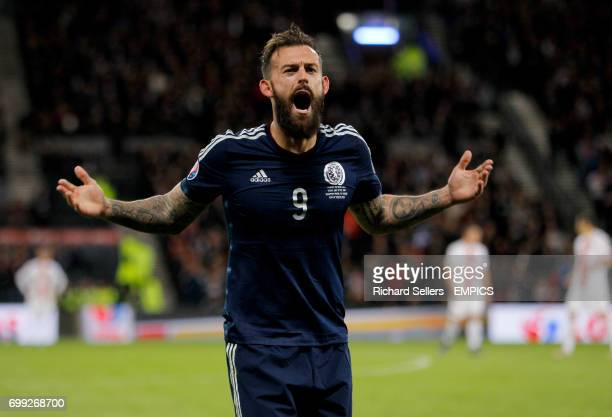 Scotland's Steven Fletcher celebrates after he scores their second goal