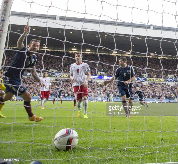 Scotland's Steven Fletcher celebrates as Shaun Maloneys shot is deflected in for the first goal