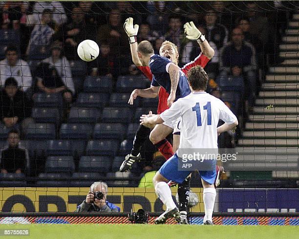 Scotland's Steven Fletcher heads the ball to score against Iceland's goalkeeper Gunnleifur Gunnleifsson during the FIFA World Cup 2010 European...