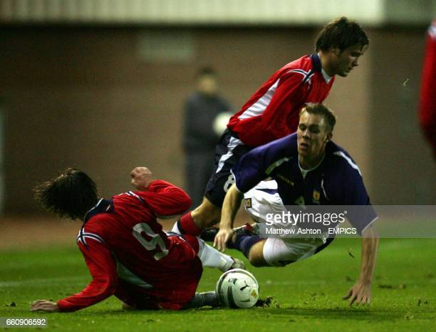 Scotland's Steven Whittaker is brought down by Norway's Kristofer Haestad and Daniel Fredheim
