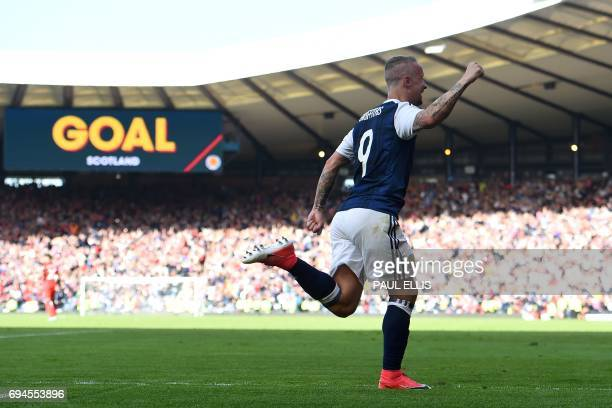 Scotland's striker Leigh Griffiths celebrates after scoring their second goal during the group F World Cup qualifying football match between Scotland...