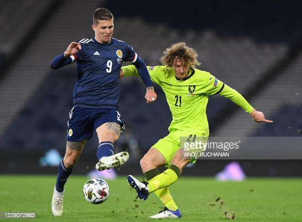 Scotland's striker Lyndon Dykes challenges Czech Republic's defender Alex Kral during the UEFA Nations League group B2 football match between...