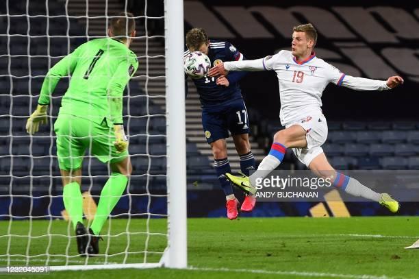 Scotland's striker Ryan Fraser headers the ball to score their fourth goal past Faroe Islands' goalkeeper Gunnar Nielsen during the FIFA World Cup...