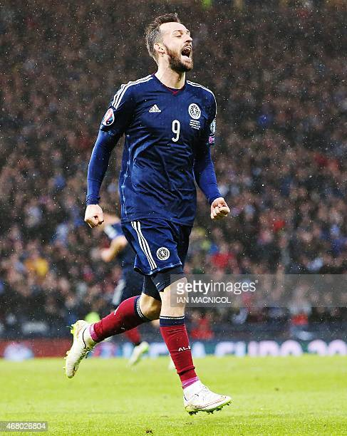 Scotland's striker Steven Fletcher celebrates after he scores his second goal during the Euro 2016 qualifying football match between Scotland and...