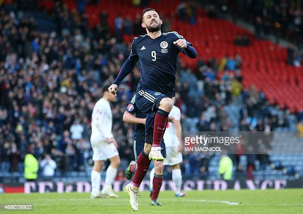Scotland's striker Steven Fletcher celebrates after he scores his third goal during the Euro 2016 qualifying football match between Scotland and...