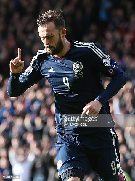 Scotland's striker Steven Fletcher celebrates after scoring their second goal during the Euro 2016 qualifying football match between Scotland and...