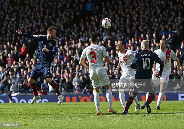 Scotland's striker Steven Fletcher scores their second goal during the Euro 2016 qualifying football match between Scotland and Gibraltar at Hampden...