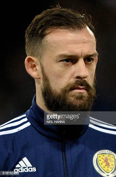 Scotland's striker Steven Fletcher stands during the national anthems at the start of the international friendly football match between Scotland and...