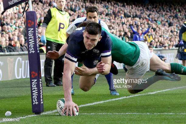 TOPSHOT Scotland's wing Blair Kinghorn dives to scores his team's first try during the Six Nations international rugby union match between Ireland...