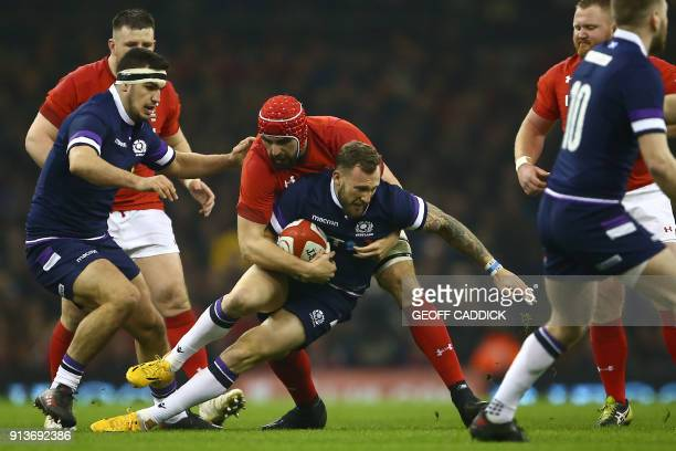 Scotland's wing Byron McGuigan is tackled by Wales' lock Cory Hill during the Six Nations international rugby union match between Wales and Scotland...