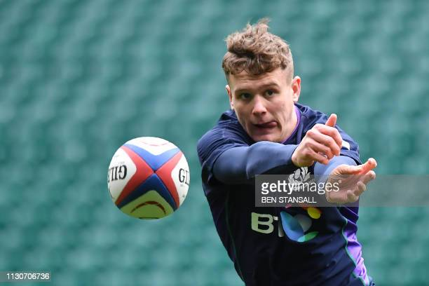 Scotland's wing Darcy Graham participates in the captain's run training session at Twickenham stadium in south west London on March 15 on the eve of...