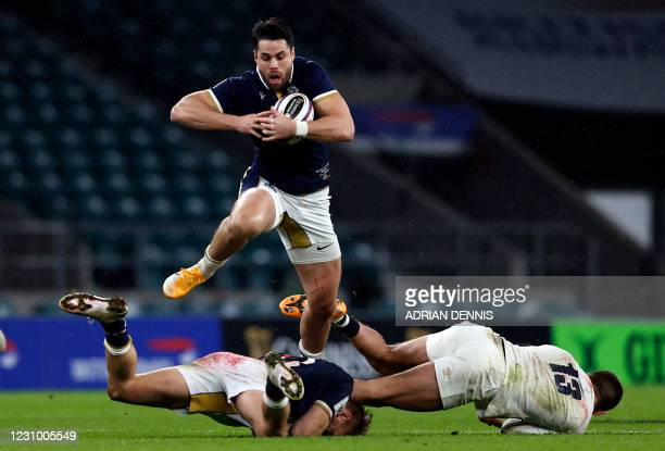 Scotland's wing Sean Maitland avoids a tackle during the Six Nations rugby union match between England and Scotland at Twickenham Stadium in south...