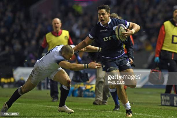 Scotland's wing Sean Maitland is tackled by England's fullback Mike Brown during the Six Nations international rugby union match between Scotland and...