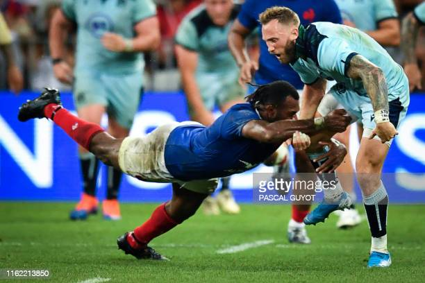 Scotland's winger Byron McGuigan is tackled by France's winger Alivereti Raka during the 2019 Rugby World Cup warmup test match between France and...
