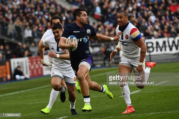 Scotland's winger Sean Maitland runs to evade France's centre Gael Fickou during the Six Nations rugby union tournament match between France and...