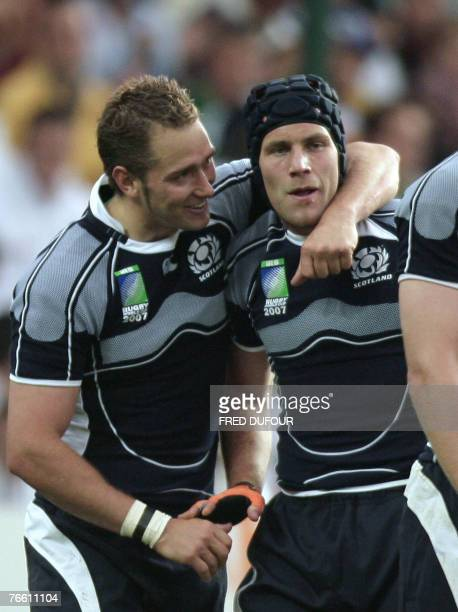 Scotland's winger Simon Webster is congratulated by team-mate and fly-half Dan Parks at the end the rugby union World Cup match Scotland vs Portugal,...