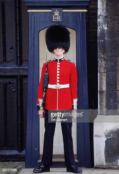 Scots Guard In Sentry Box Stationed At St James's Palace In London And Wearing Traditional Bearskin Busby Hat