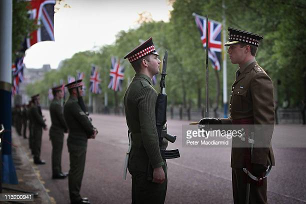 Scots Guards officer makes checks during a military dress rehearsal for the wedding of Prince William and Catherine Middleton in The Mall on April...