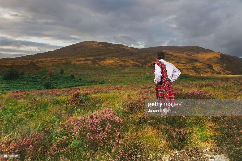 Scotsman in kilt on the Moors : Stock Photo