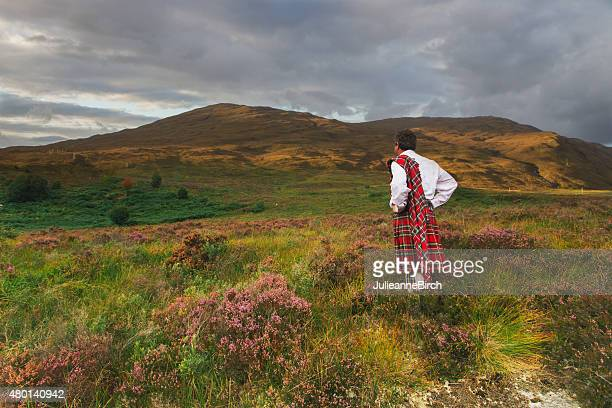 scotsman in kilt on the moors - kilt stock photos and pictures