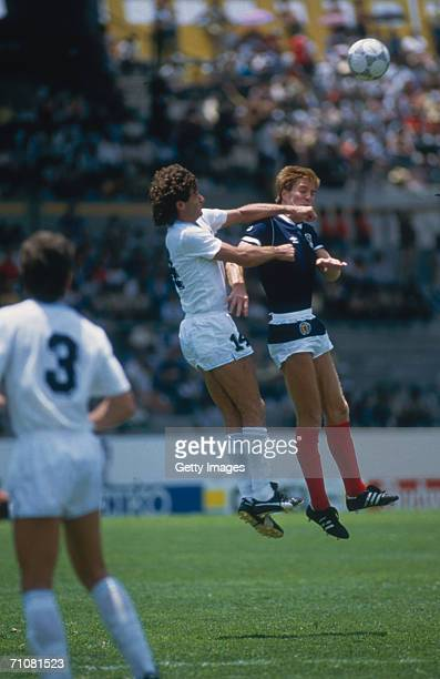 Scotsman Richard Gough jumps for the ball with Pereyra during the 1986 World Cup match between Scotland and Uruguay in the Neza Stadium Mexico 13th...