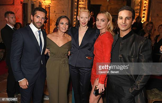 Scott Adkins, Zara Phythian, Tilda Swinton, Katrina Durden and Alaa Safi attend Marvel Studios and British GQ hosted reception in The Cloisters at...