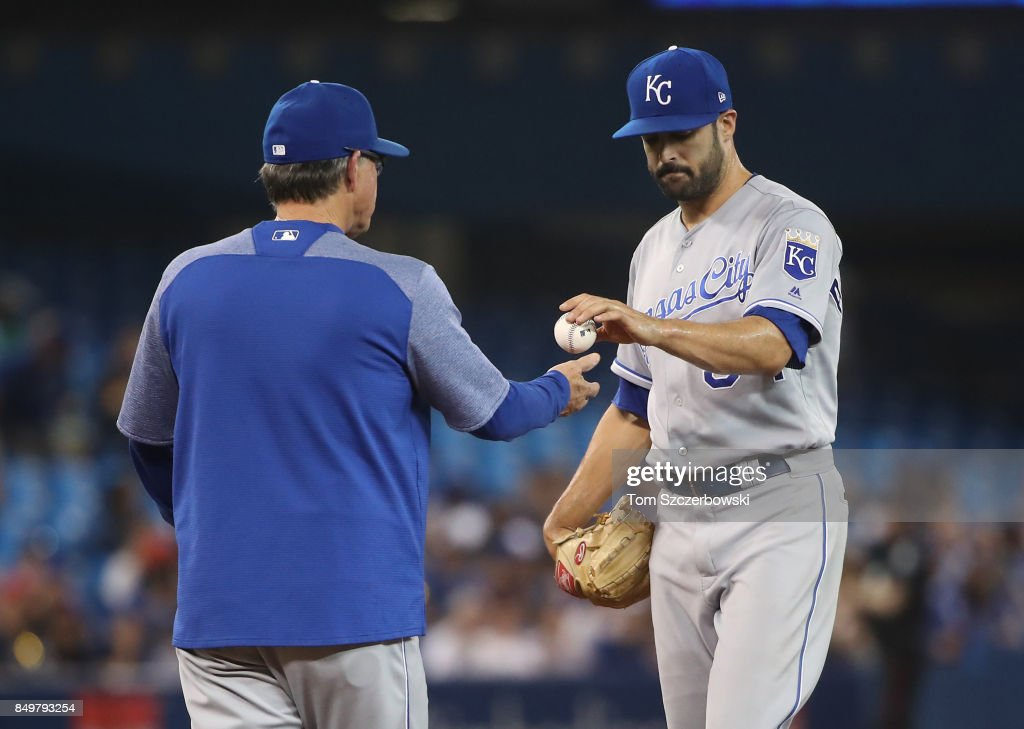 Scott Alexander #54 of the Kansas City Royals gives the baseball up to manager Ned Yost #3 as he is relieved in the seventh inning during MLB game action against the Toronto Blue Jays at Rogers Centre on September 19, 2017 in Toronto, Canada.