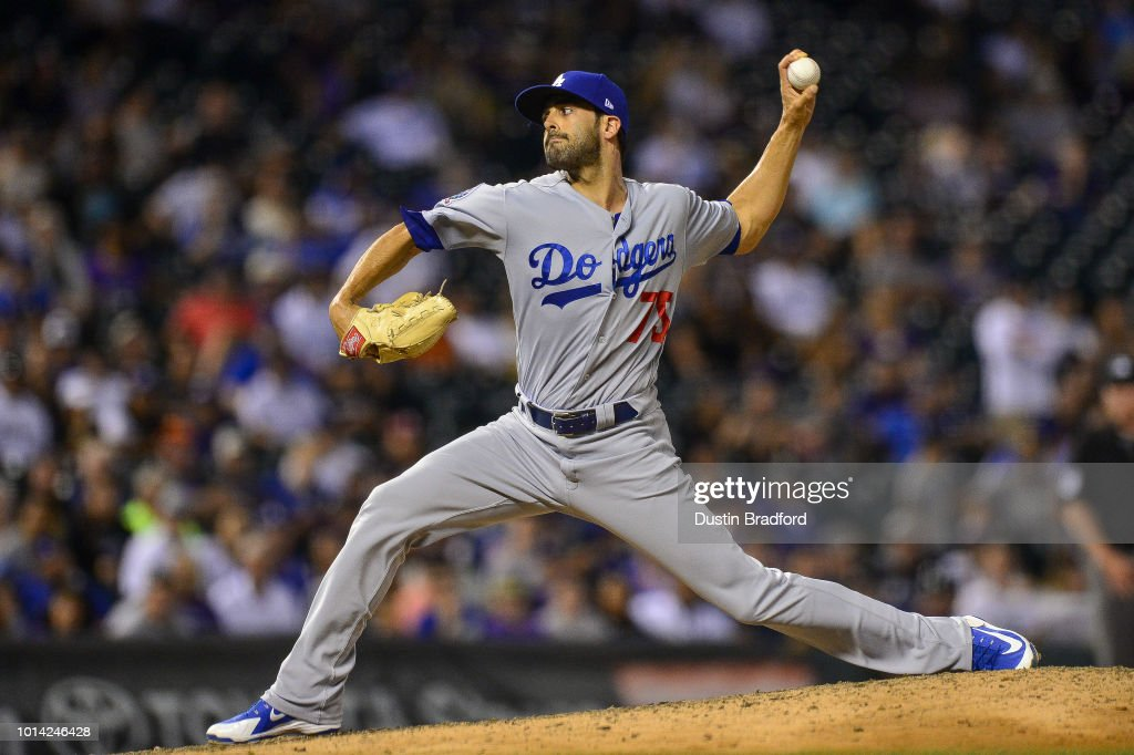 Scott Alexander #75 of the Los Angeles Dodgers pitches in the ninth inning of a game against the Colorado Rockies at Coors Field on August 9, 2018 in Denver, Colorado.