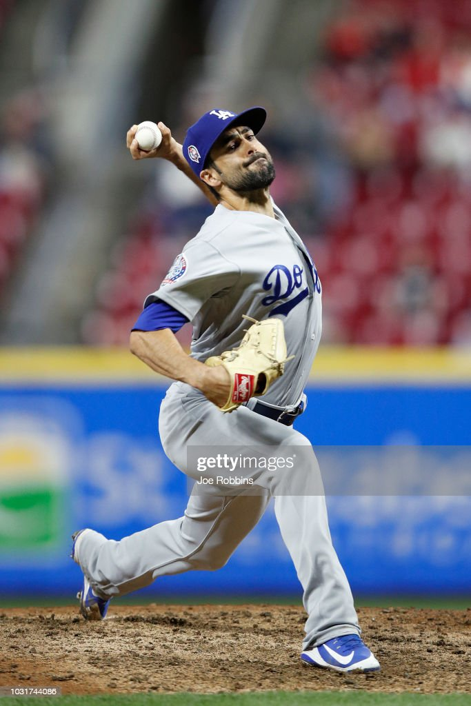 Scott Alexander #75 of the Los Angeles Dodgers pitches in the seventh inning of the game against the Cincinnati Reds at Great American Ball Park on September 11, 2018 in Cincinnati, Ohio. The Reds won 3-1.