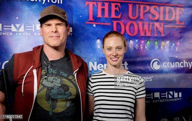 EJ Scott and Deborah Ann Woll attend The Upside Down A Stranger Party presented by Nerdist at Fluxx Nightclub on July 18 2019 in San Diego California