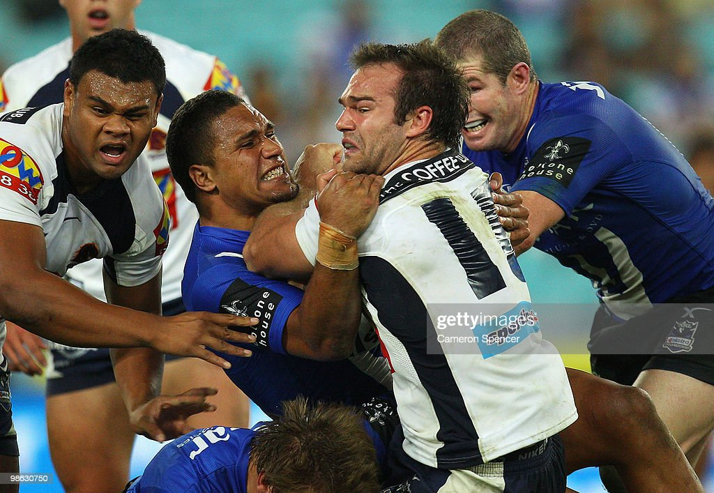 Scott Anderson of the Broncos is tackled by Yileen Gordon of the Bulldogs during the round seven NRL match between the Canterbury Bulldogs and the Brisbane Broncos at ANZ Stadium on April 23, 2010 in Sydney, Australia.