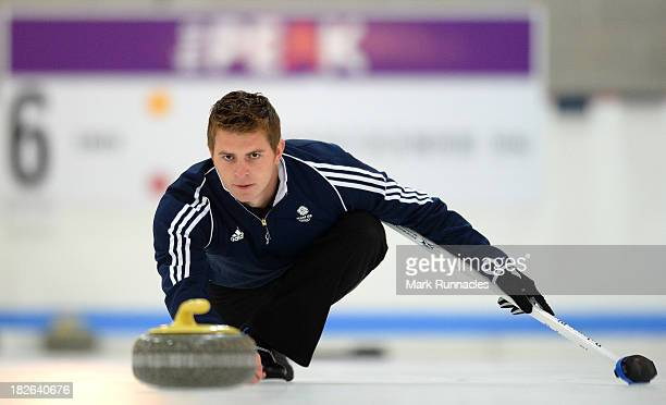 Scott Andrew throws a stone during a training session after being selected for the Team GB Curling team for the Sochi 2014 Winter Olympic Games at...