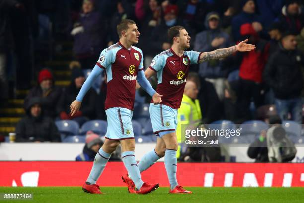 Scott Arfield and Chris Wood of Burnley appeal to the officials after having a goal dissalowed during the Premier League match between Burnley and...