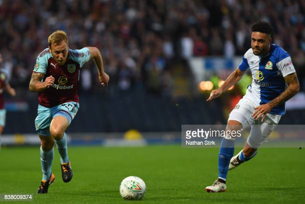 Scott Arfield of Burnley and Derrick Williams of Blackburn in action during the Carabao Cup Second Round match between Blackburn Rovers and Burnley...