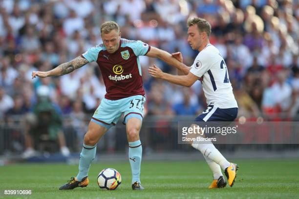 Scott Arfield of Burnley holds off Christian Eriksen of Tottenham Hotspur during the Premier League match between Tottenham Hotspur and Burnley at...