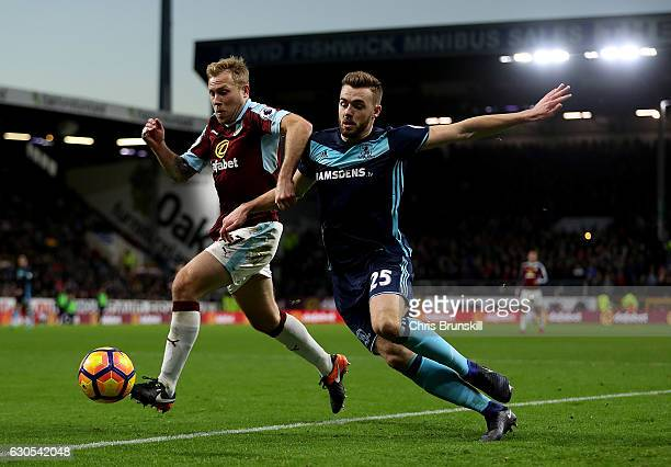 Scott Arfield of Burnley holds off the challenge of Calum Chambers of Middlesbrough during the Premier League match between Burnley and Middlesbrough...
