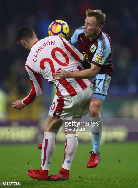 Scott Arfield of Burnley in action with Geoff Cameron of Stoke City during the Premier League match between Burnley and Stoke City at Turf Moor on...