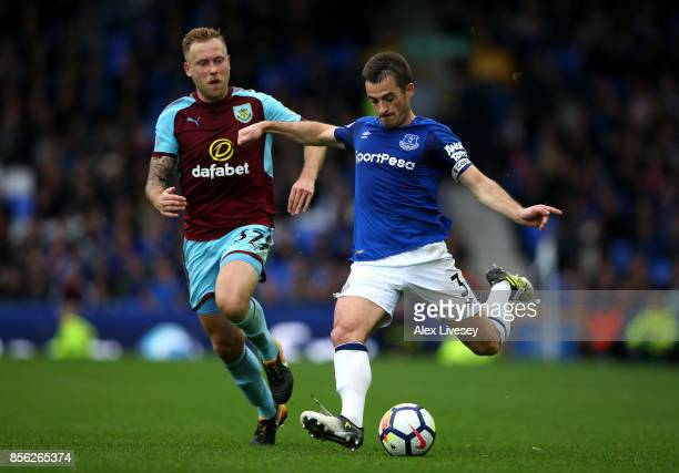 Scott Arfield of Burnley puts pressure on Leighton Baines of Everton during the Premier League match between Everton and Burnley at Goodison Park on...