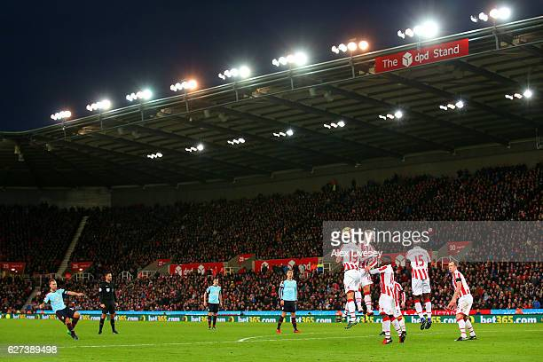 Scott Arfield of Burnley shoots from a free kick during the Premier League match between Stoke City and Burnley at Bet365 Stadium on December 3 2016...