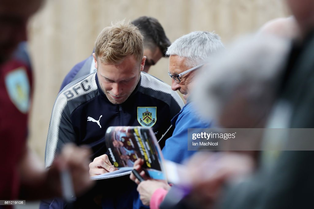 Scott Arfield of Burnley signs autographs prior to the Premier League match between Burnley and West Ham United at Turf Moor on October 14, 2017 in Burnley, England.