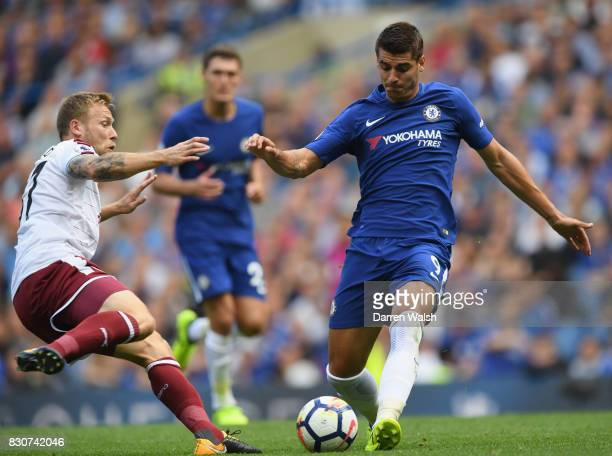 Scott Arfield of Burnley tackles Alvaro Morata of Chelsea during the Premier League match between Chelsea and Burnley at Stamford Bridge on August 12...