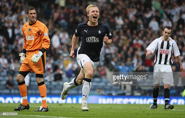 Scott Arfield of Falkirk scores from the penalty spot during the Scottish Cup semi final between Dunfermline and Falkirk at Hampden Park on April 26...