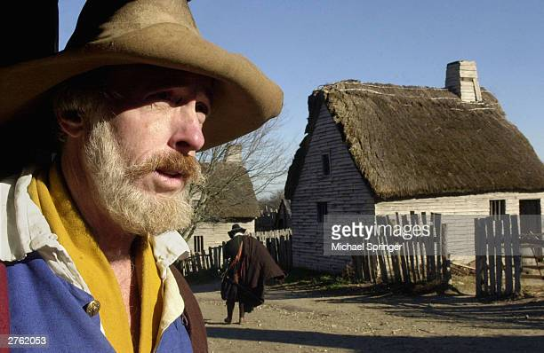 Scott Atwood who portrays pilgrim Robert Hicks looks across the main street of Plimoth Plantation November 25 2003 at Plimoth Plantation in Plymouth...