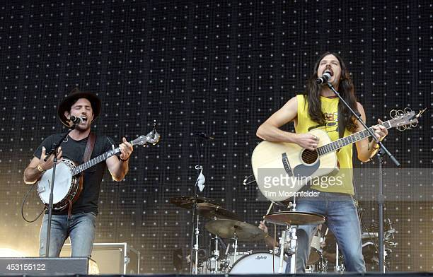 Scott Avett and Seth Avett of the Avett Brothers perform at 2014 Lollapalooza at Grant Park on August 3 2014 in Chicago Illinois