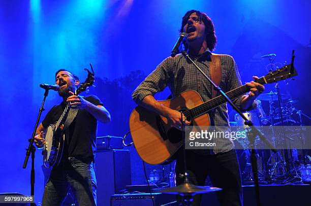 Scott Avett and Seth Avett of The Avett Brothers perform on stage at the O2 Shepherd's Bush Empire on August 30 2016 in London England